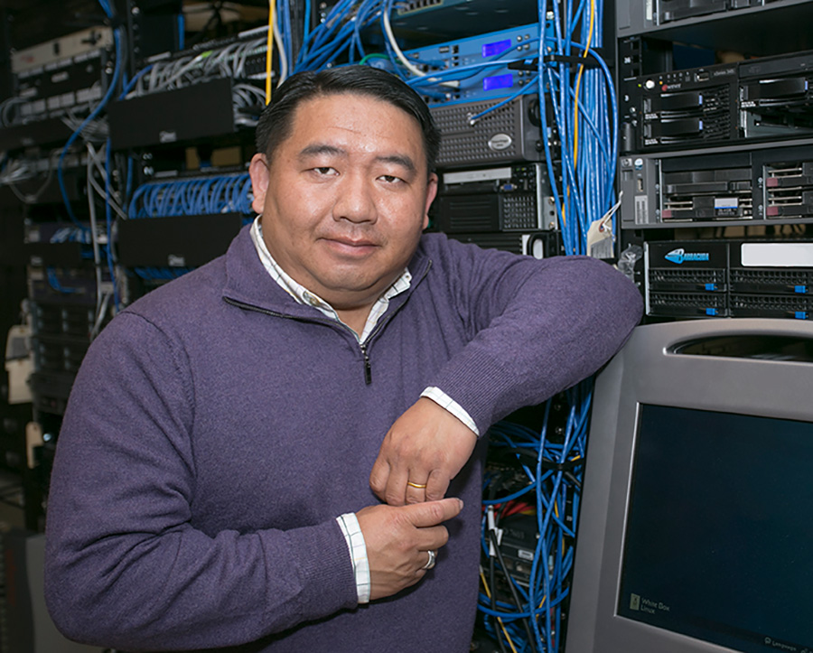Tou Vue was a tiny infant when his parents fled Laos as communist forces enacted revenge on the Hmong for supporting American troops. Now he's a network engineer for the Lansing School District and has three children of his own.